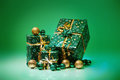 Gift boxes and christmas balls isolated on green background studio photo of Royalty Free Stock Photo
