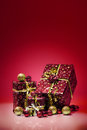 Gift boxes and christmas balls isolated on red background studio photo of Royalty Free Stock Images