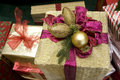 Gift boxes golden ball ribbon Royalty Free Stock Photo