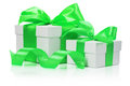 Gift boxes with green bow isolated on the white background Royalty Free Stock Photo