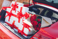 Gift boxes in a luggage carrier of the red car Royalty Free Stock Photo