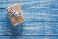 Gift boxes in paper on a blue wooden table Royalty Free Stock Photo