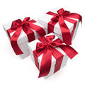 Gift boxes with red ribbons and bows. Royalty Free Stock Image