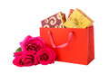 Gift boxes in shopping bag and pink roses isolated Royalty Free Stock Photo