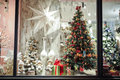 Gift boxes , sweets and christmas decor in shop window Royalty Free Stock Photo