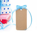 Gift boxes and tag on white background Stock Photos