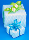 Gift boxes two with green and blue bow on blue background Royalty Free Stock Photo