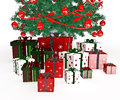 Gift boxes under christmas tree on white Royalty Free Stock Images
