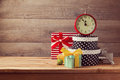 Gift boxes and watch on wooden table new year celebration concept retro Royalty Free Stock Photo
