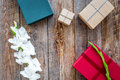 Gift boxes wrapped in colored paper tied up with ribbon on wooden background top view copyspace Royalty Free Stock Photo