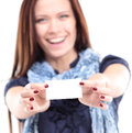 Gift card. Excited woman showing empty blank paper card sign Royalty Free Stock Photo