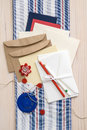 Gift card making supplies stationary envelopes cards paper pins string buttons and fabric on wood table Stock Photo
