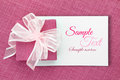 Gift card pink box with ribbon on white Stock Image