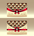 Gift cards with geometric pattern red bow ribbon gold color Royalty Free Stock Photos