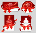 Gift cards with red bows set of christmas on a gray background Royalty Free Stock Photo