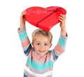 Gift of chocolates in heart shaped box from a young boy Royalty Free Stock Images