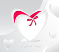 Gift in form white heart and with red bow pearl Royalty Free Stock Photos