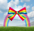 Gift of fortune and gifts from heaven concept with a colorful rainbow shaped as a fun and happy holiday ribbon and bow on a sky Royalty Free Stock Photo
