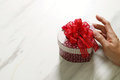 gift giving,man hand holding a heart shape gift box in a gesture Royalty Free Stock Photo
