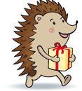 Gift hedgehog is carrying a Stock Photography