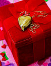 Gift of love heart on a chain sits on a red velvet box Royalty Free Stock Images