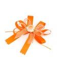 Gift orange ribbon and bow on white background a Stock Image