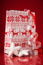 Gift packet with christmas ornaments on red background. Winter holidays. Royalty Free Stock Photo