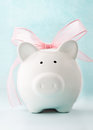 Gift piggy bank cute with pink bow and ribbon front view Stock Images