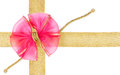 Gift pink bow on the gold ribbon isolated on white background Stock Image