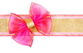 Gift pink bow on the ribbon isolated on white background Royalty Free Stock Images