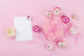 Gift or present, paper blank and beautiful flower on pink desk from above for wedding mockup or greeting card on womans day Royalty Free Stock Photo
