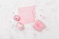 Gift or present, pink paper blank and ranunculus flower on white table top view for wedding mockup or greeting card flat lay. Royalty Free Stock Photo