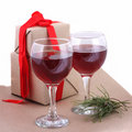 Gift with red ribbon and glasses Royalty Free Stock Photo
