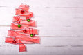 Gift ribbon christmas tree with ornaments Royalty Free Stock Photo