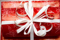 Gift ribbon on red paper Royalty Free Stock Photography
