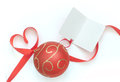 Gift tag for christmas heart shaped ribbon bow attached to bauble and blank card Stock Image