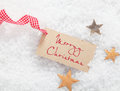 Gift tag with Merry Christmas greeting Stock Image