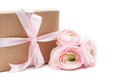 Gift tied with ribbon and pink flowers Royalty Free Stock Photo