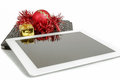 Gift white tablet with christmas ball box and red chain on background Stock Photography