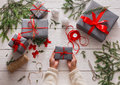 Gift wrapping. Packaging modern christmas present in boxes Royalty Free Stock Photo