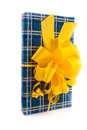 Giftbox blue with yellow ribbon isolated on white Stock Photography