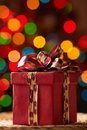 Giftbox image of christmas decorated with knot on sparkling background Royalty Free Stock Photos