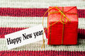 Giftbox red with happy new year text on red background Royalty Free Stock Images