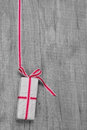 Giftbox with red striped ribbon for christmas or birthday wood Royalty Free Stock Photography
