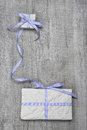 Giftboxes with blue striped ribbon on a wooden background for birthday father s day or for voucher or coupon Royalty Free Stock Photos