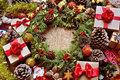 Gifts and christmas ornaments on a rustic wooden table