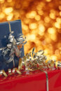 The gifts christmas presents with golden holiday background Stock Image