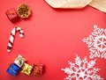 Gifts on red white snowflake holiday decoration close studio shot Stock Photos