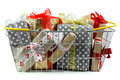 Gifts in shopping basket closeup Royalty Free Stock Photo