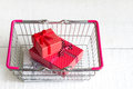Gifts in shopping basket Royalty Free Stock Photo